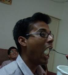 Eating Rasogolla